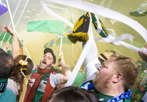 Photo of the Timber's Army celebrating a goal against their rivals, Seattle